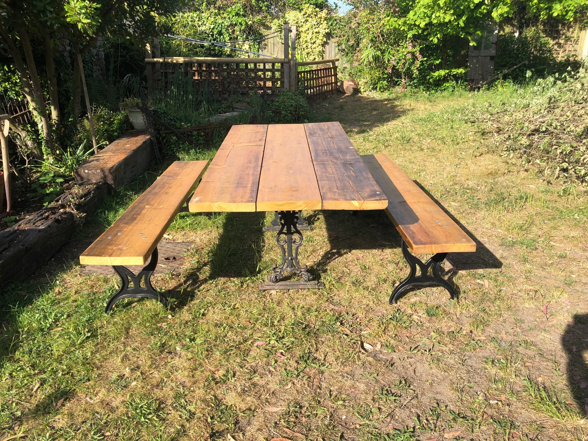 Garden table and benches - iron bases with reclaimed timber tops.
