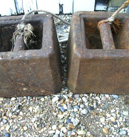 Cast iron weights or dead anchors