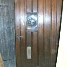 Oak arts and crafts period external door with bullseye
