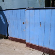 Dado level painted pitch pine wall panelling.