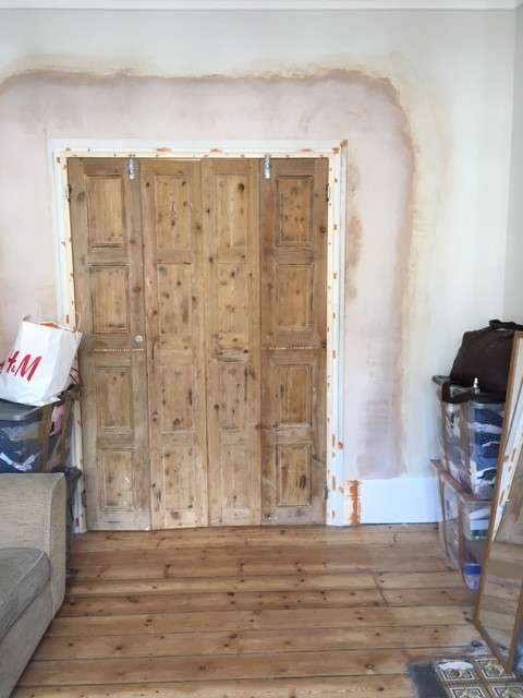 Lounge partition using Georgian window shutters.