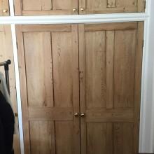 Built in wardrobe using reclaimed doors