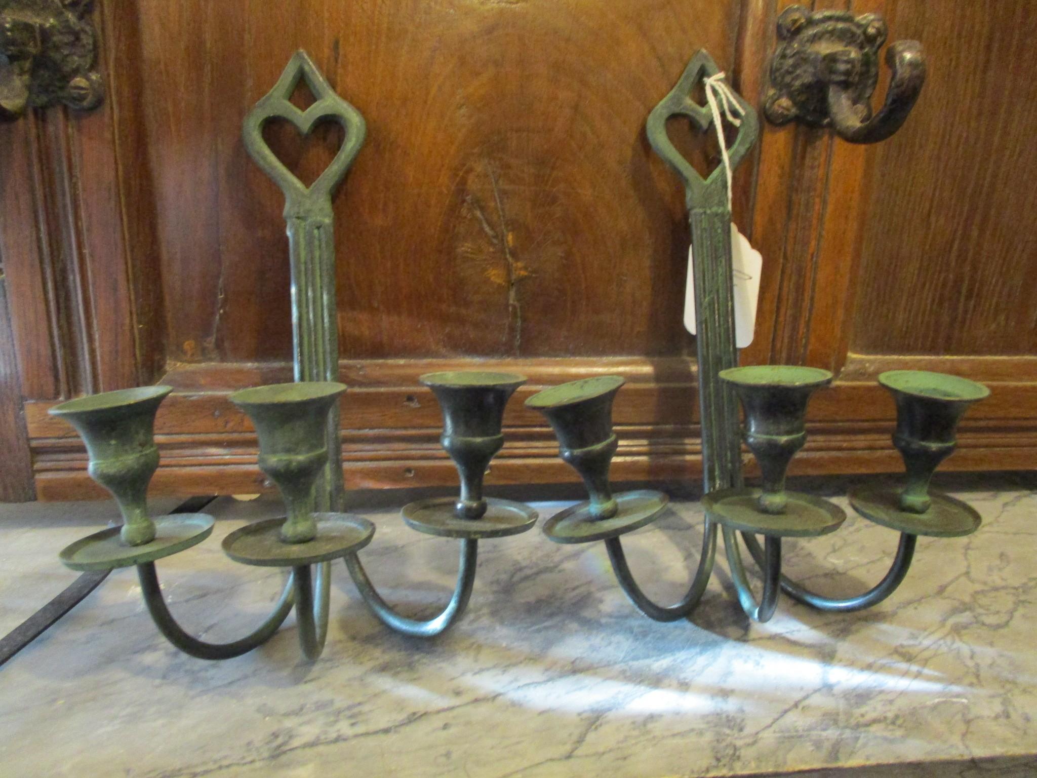 wrought iron wall hung candlesticks