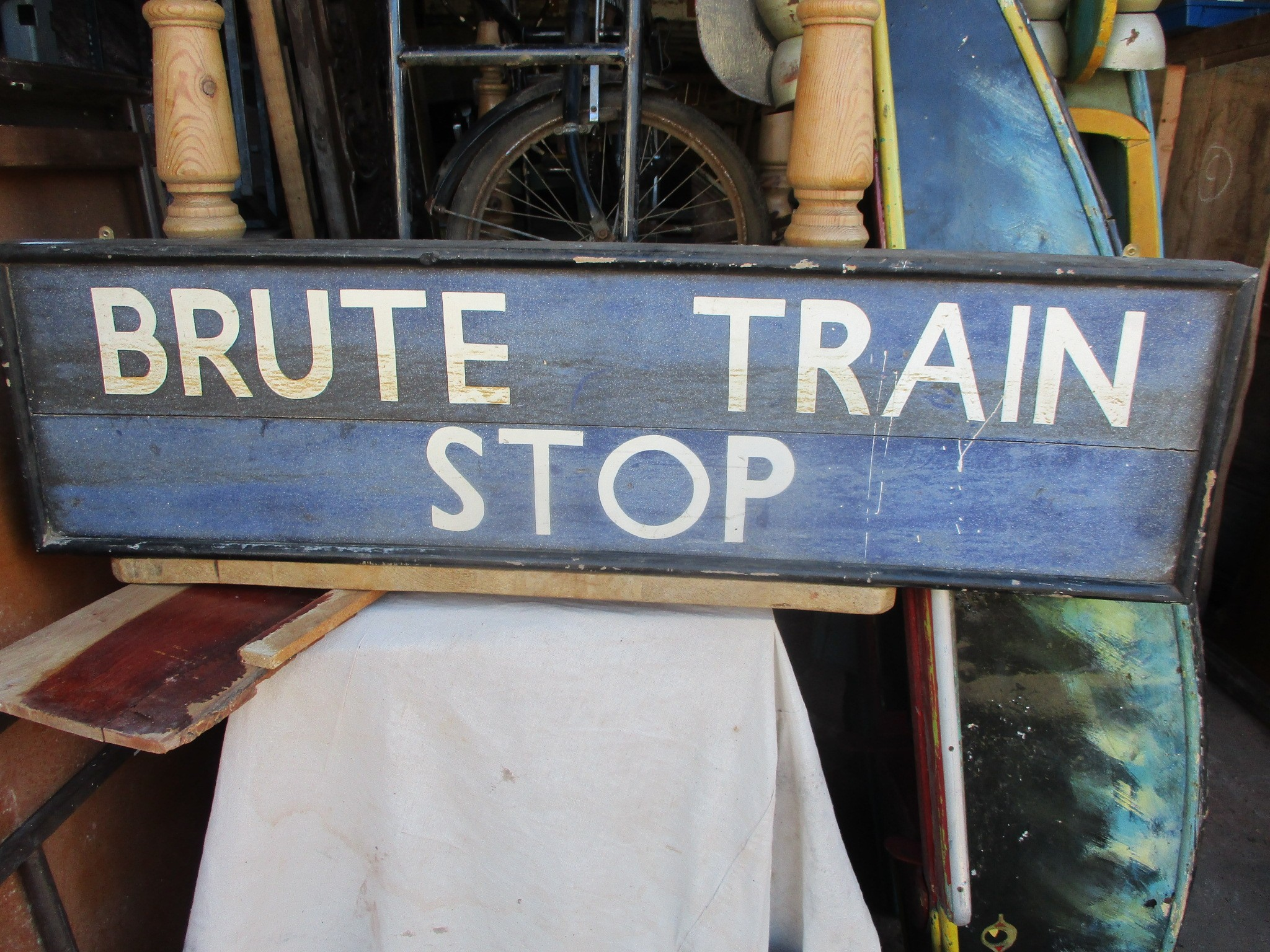 Brute Train Stop , hand painted on wood signage
