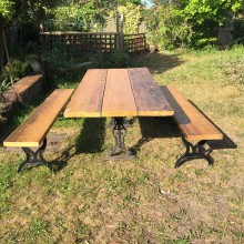 Table and benches - iron bases with reclaimed timber tops.