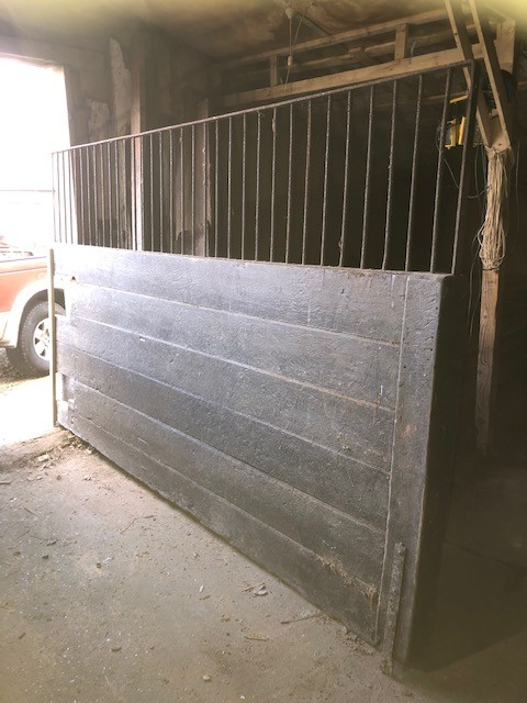 Stable siding wrought iron fenced top