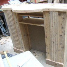 Fire-surround and plasma screen stand in construction