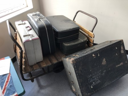 Suitcase trolley or porters trolley - with suitcases as required.